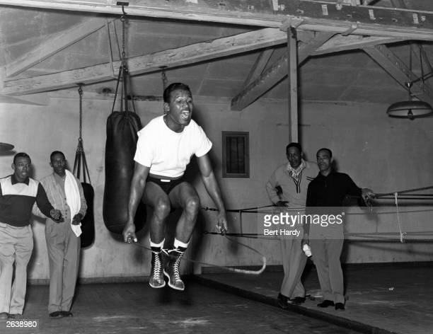 American boxer Sugar Ray Robinson in training in Roger Oquinarenne's Paris gymnasium for his world middleweight fight against Britains Randolph...