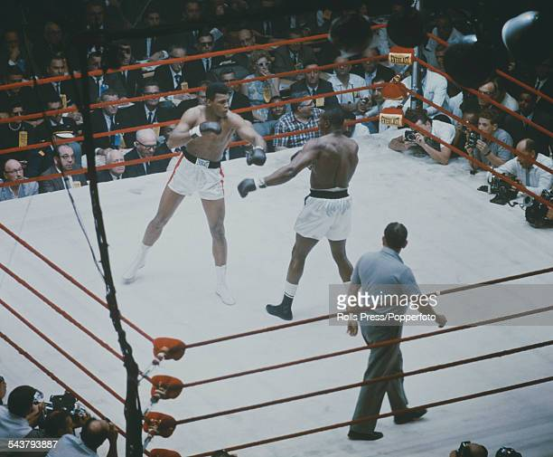 American boxers Cassius Clay and Sonny Liston pictured together in a World Heavyweight title fight at the Convention Hall in Miami Beach Florida on...
