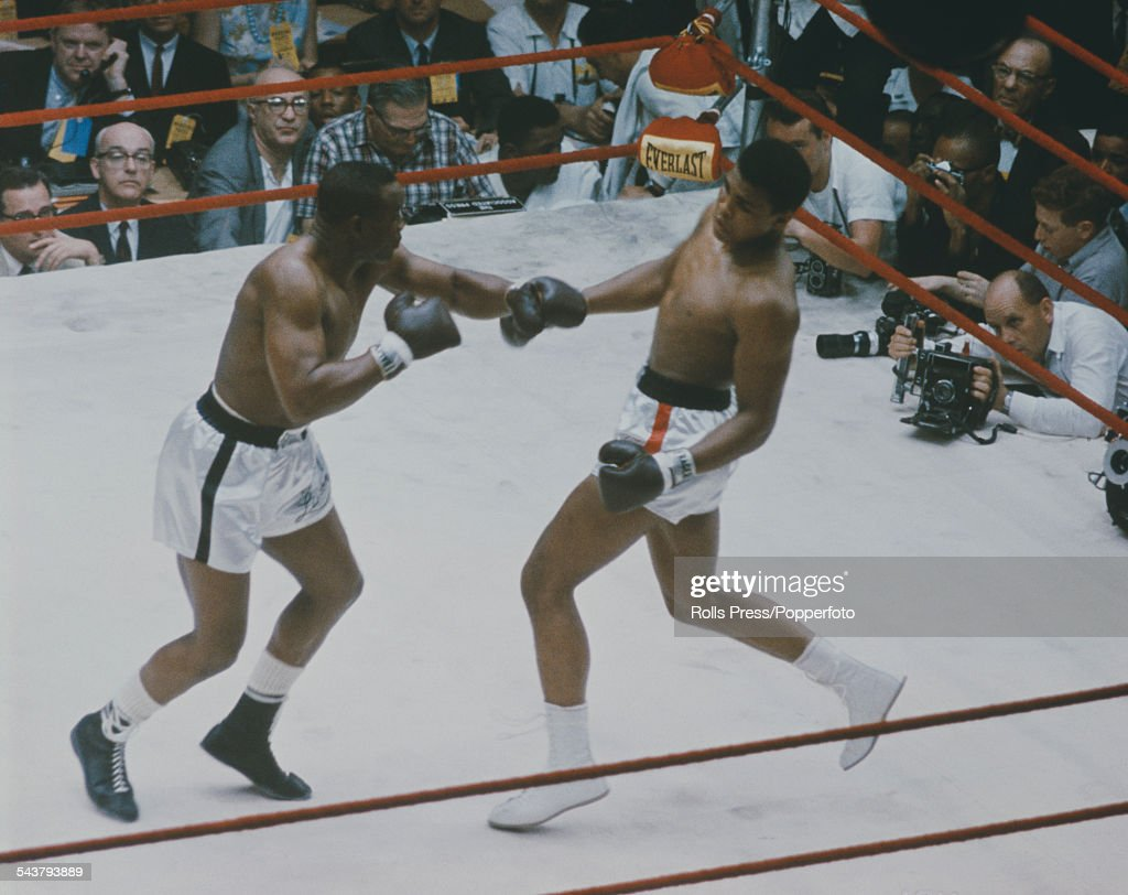 American boxers Cassius Clay (Muhammad Ali) and Sonny Liston pictured together in a World Heavyweight title fight at the Convention Hall in Miami Beach, Florida on 25th February 1964.