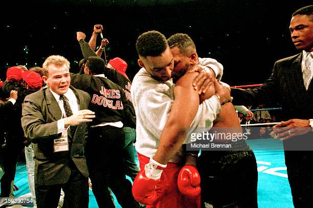 American boxers James 'Buster' Douglas and Mike Tyson embrace after their world heavyweight title fight at the Tokyo Dome in Tokyo Japan 11th...