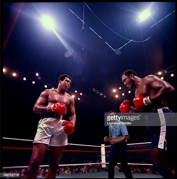 American boxers Muhammad Ali and Joe Frazier face off in the ring at Araneta Coliseum Quezon City Philippines October 1 1975 Referee Carlos Padilla...