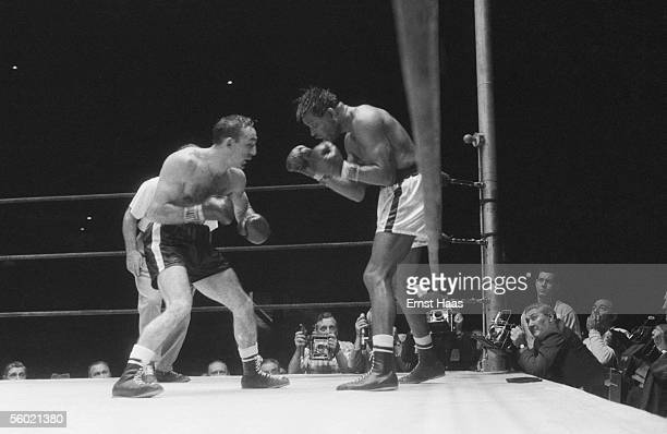American boxers Sugar Ray Robinson and Carmen Basilio during their World Middleweight title rematch at Chicago Stadium 25th March 1958 Robinson won...