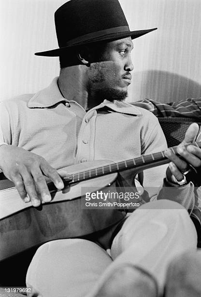 American boxing champion Joe Frazier playing the guitar 4th March 1971