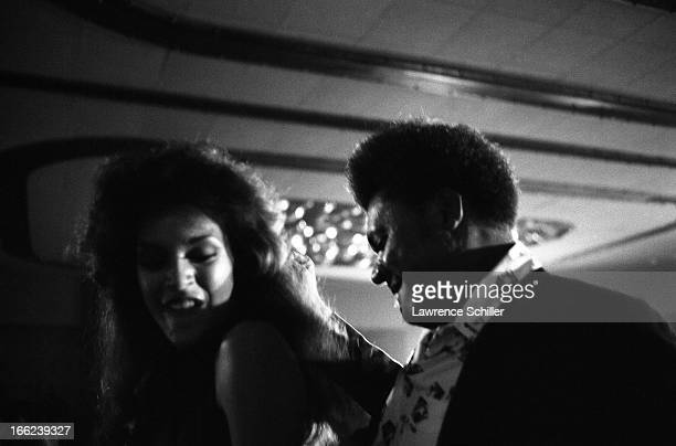 American boxing promoter Don King dances with an unidentified woman at a nightclub Manila Philippines mid to late September 1975 He was in the...