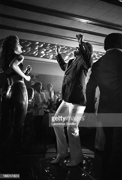 American boxing promoter Don King dances with an unidentified woman at a nightclub, Manila, Philippines, mid to late September 1975. He was in the...