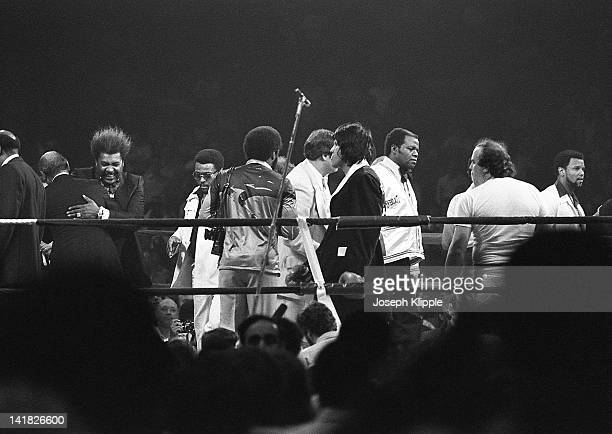 American boxing promotor Don King embraces an unidentified man in the ring during a Heavyweight Championship bout between American Muhammad Ali and...