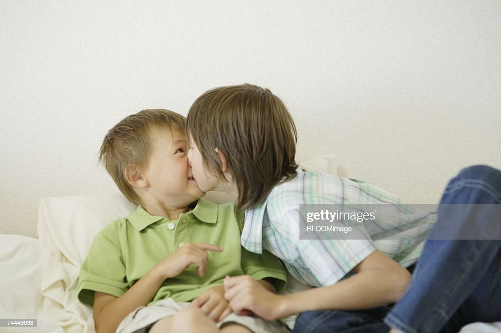 American Boys Kissing On Bed High-Res Stock Photo - Getty