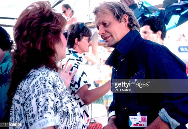 American British musician and actor David Soul speaks with an unidentified woman backstage during the Farm Aid 2 benefit concert Austin Texas July 4...