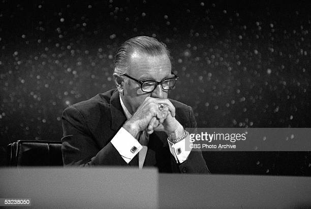 American broadcast journalist and TV news anchor Walter Cronkite keeps his eyes on his monitor as NASA's Apollo 11 mission touches down on the moon...