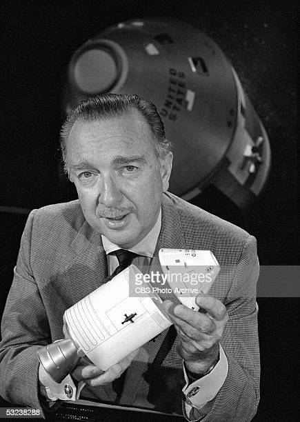 American broadcast journalist and TV news anchor Walter Cronkite uses a model to help explain NASA's Apollo 7 mission during his coverage of the...