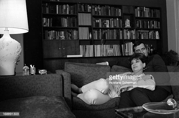 American broadcast journalist Barbara Walters and her husband, businessman and theatre producer Lee Guber , relax at home, New York, 1966.