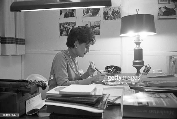 American broadcast journalist Barbara Walters eats a sandwich as she works at her desk, New York, New York, 1966.