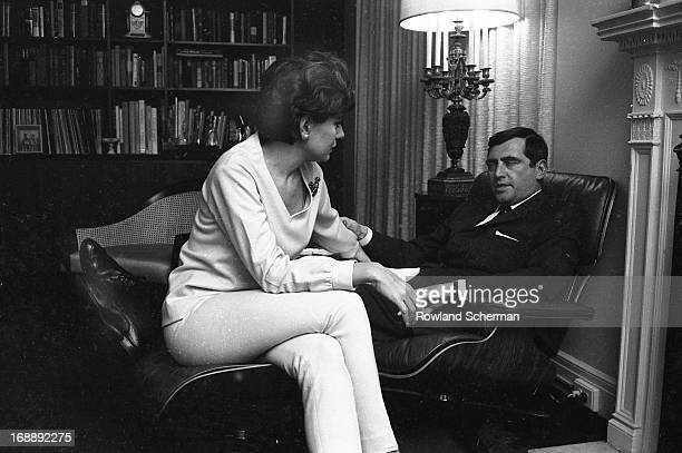 American broadcast journalist Barbara Walters sits at home with her husband, businessman and theatre producer Lee Guber , New York, 1966.