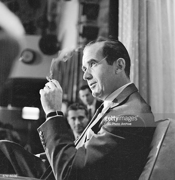 American broadcast journalist Edward R. Murrow smokes a cigarette on the set of 'The Ed Sullivan Show,' New York, New York, October 16, 1955.