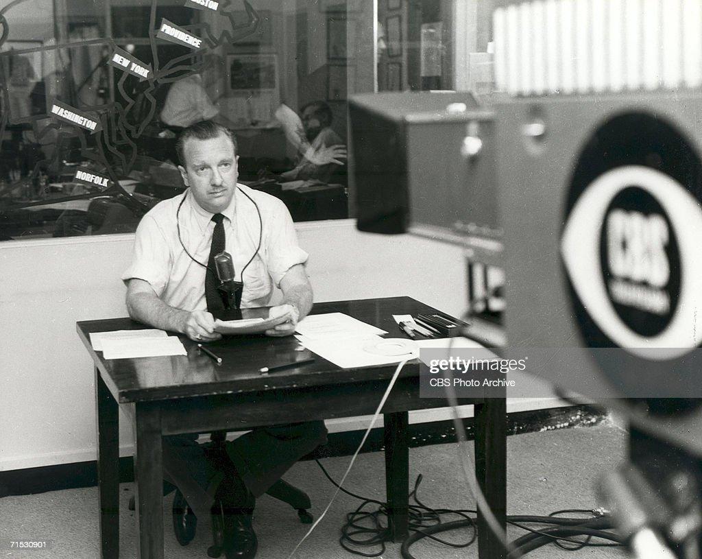 American broadcast journalist Walter Cronkite wears a short