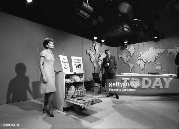 American broadcast journalists Barbara Walters and Hugh Downs stand with a dishwasher on the 'Today' show set, New York, New York, 1966.