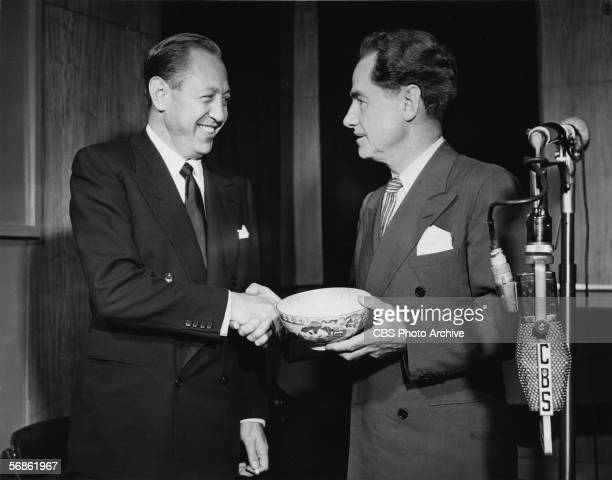 American broadcast network executive president of CBS radio and founder of CBS television William S Paley shakes hands with American writer broadcast...