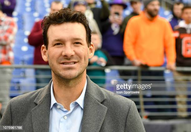 American broadcaster and former NFL quarterback Tony Romo watches the Cleveland Browns and the Baltimore Ravens warm up prior to their game on...
