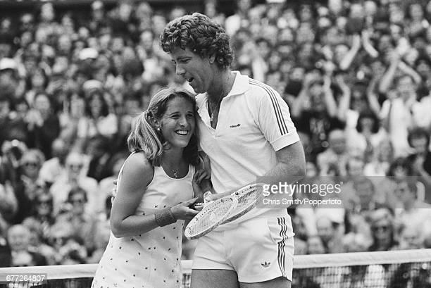 American brother and sister tennis players John Austin and Tracy Austin embrace and congratulate each other after defeating Dianne Fromholtz and Mark...