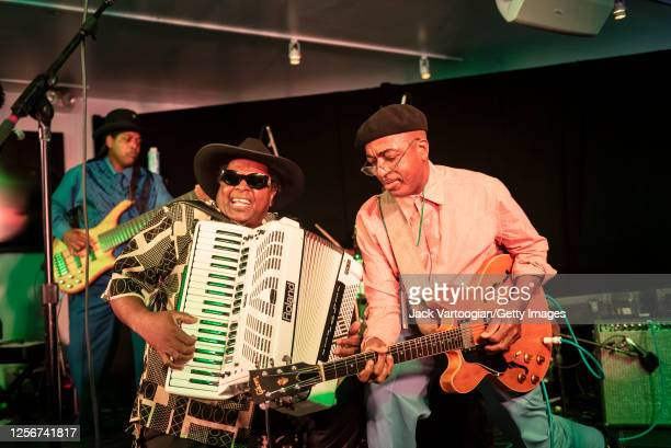 American brothers and Zydeco musicians Nathan Williams , on piano accordion, and Dennis Paul Williams, on guitar, perform with Nathan and the Zydeco...