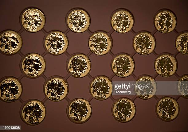 American Buffalo gold bullion coins sit in a tray at the United States Mint at West Point in West Point New York US on Wednesday June 5 2013 Sales of...