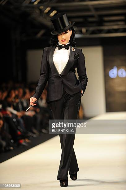 American burlesque artist Dita Von Teese presents a creation by Damat Tween at the Istanbul Fashion Week on February 4 in Istanbul The Istanbul...