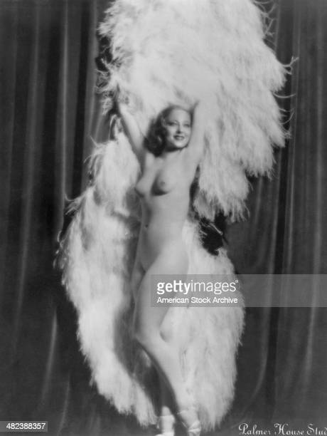 American burlesque dancer and actress Sally Rand performing her her ostrich feather fan dance circa 1930