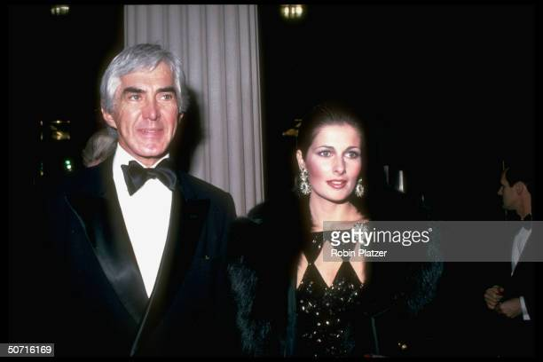 American businessman and automobile executive John DeLorean and his third wife model and actress Cristina Ferrare arrive at the opening of the...