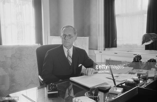 American businessman and politician Joseph P Kennedy Sr United States Ambassador to the United Kingdom pictured seated at a desk in his office at the...