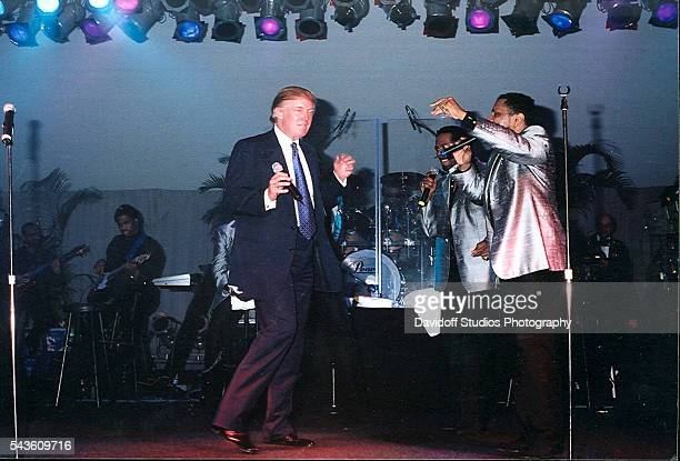American businessman Donald Trump dances onstage with an unidentified music group during a performance at the MaraLago estate Palm Beach Florida 2005