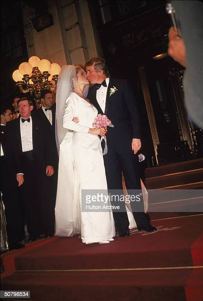 American businessman Donald Trump kisses his new bride Marla Maples following their wedding ceremony at Trump Plaza hotel New York City December 19...