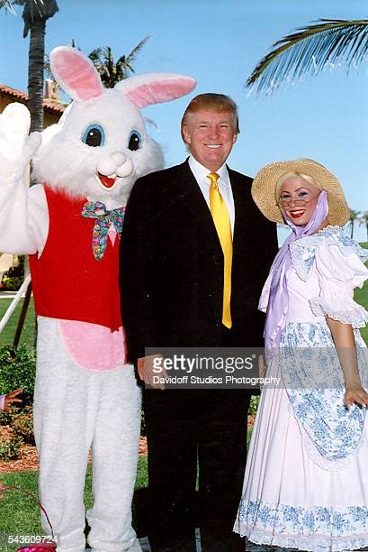 American businessman Donald Trump poses the Easter Bunny and BoPeep during an Easter Sunday event at the MaraLago estate Palm Beach Florida 2006