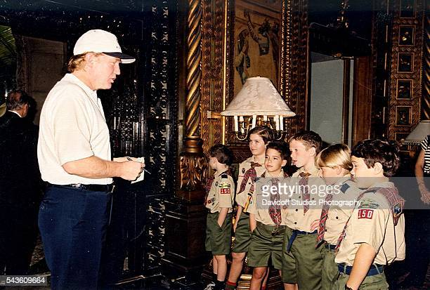 American businessman Donald Trump talks with a group of Boy Scouts on a tour of the MaraLago estate Palm Beach Florida 1999