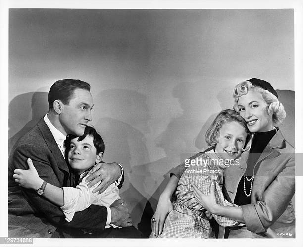 American businessman Gene Kelly and French woman Barbara Laage are finally reunited with their respective children Bobby Clark and Brigitte Fossey in...
