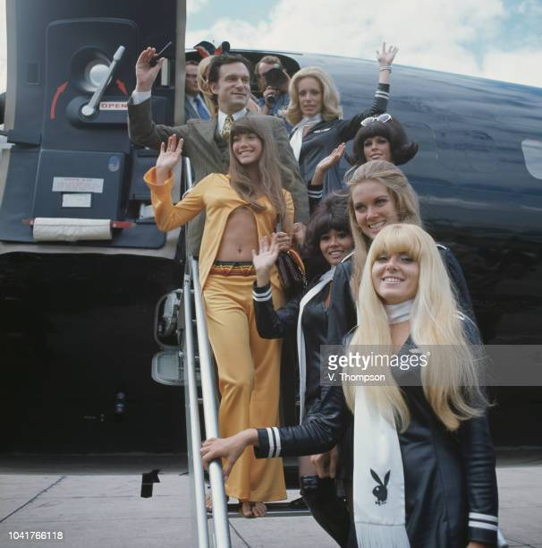 American businessman Hugh Hefner and his girlfriend Barbi Benton arrive at London Airport on board his private jet 'Big Bunny' accompanied by a group...