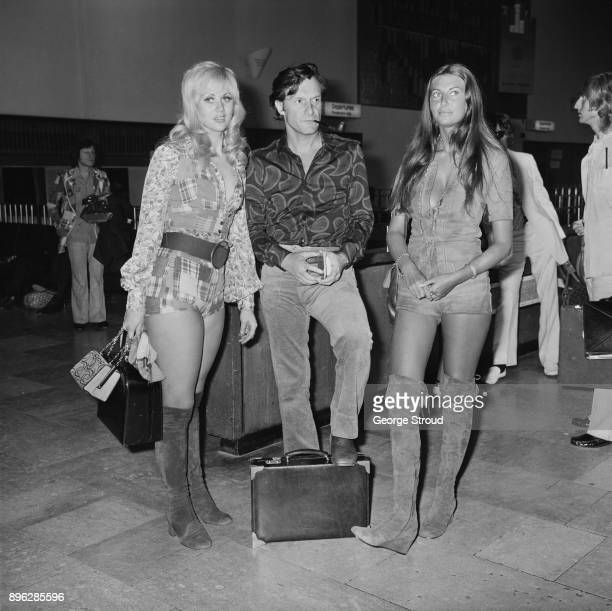 American businessman Hugh Hefner with Playboy's playmates Rosamund Teller and Marilyn Cole at Heathrow Airport London UK 11th August 1971