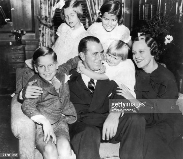 American businessman, politician and Olympic rowing champion John B. Kelly, Sr. With his wife Margaret and their children, circa 1935. Standing, left...