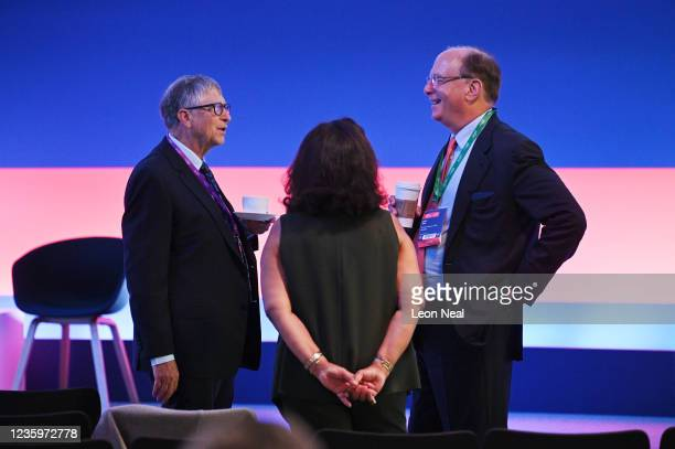 American Businessmen Bill Gates and Larry Fink chat prior to the Global Investment Summit at the Science Museum on October 19, 2021 in London,...