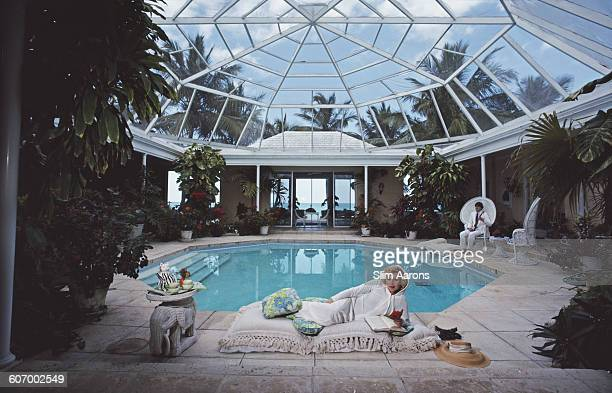 American businesswoman and socialite Joanne King Herring and her son Robin King at Villa Caprice in Lyford Cay in the Bahamas April 1983
