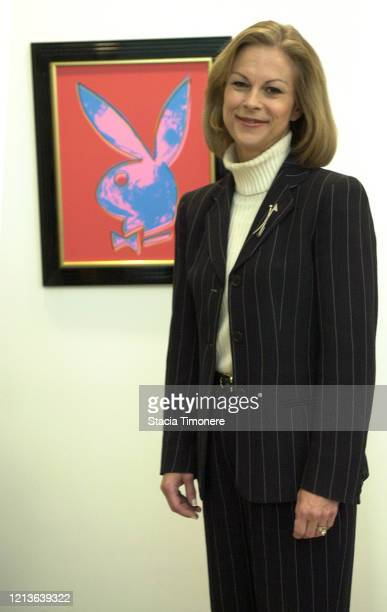 American businesswoman Christie Hefner in her office at Playboy headquarters in Chicago, Illinois USA on November 26, 2003. Behind her is a Playboy...