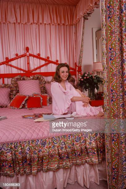 American businesswoman Helen Gurley Brown poses wearing a pink dress on her bed in her apartment on Central Park West New York New York January 1979...