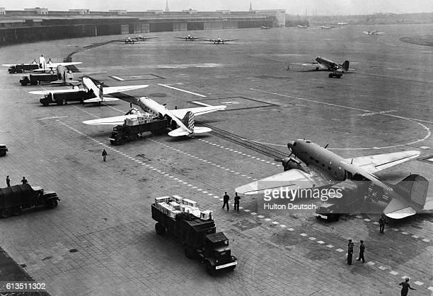 American C47 Skytrain transport planes have their cargoes of food unloaded at Templehof Airport during the Berlin Airlift