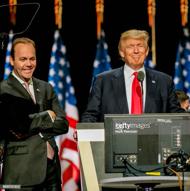 American campaign advisor Rick Gates and real estate developer presidential candidate Donald Trump on stage during the sound check on the final day...