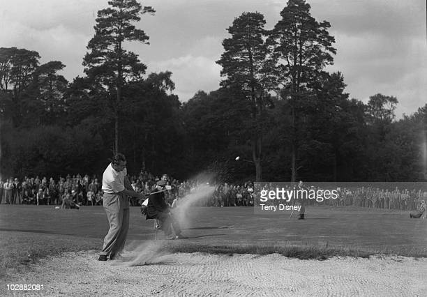 American captain Lloyd Mangrum hits out of a bunker at the 15th hole during his match against Eric Brown in the Ryder Cup singles at the Wentworth...