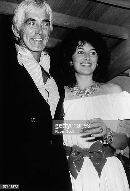 American car designer engineer and builder John DeLorean and his third wife supermodel actress and author Cristina Ferrare attend a party at Spago's...
