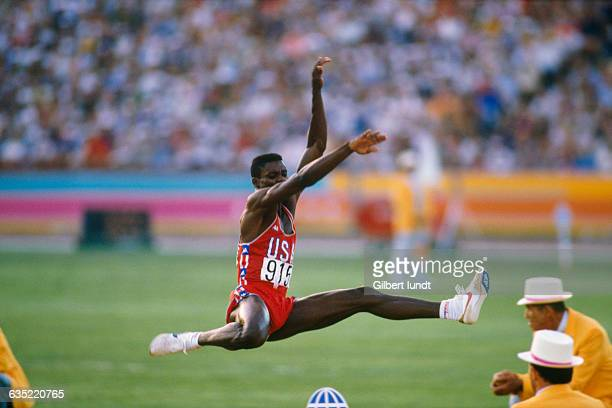 American Carl Lewis competes in the men's long jump event of the Olympic Games