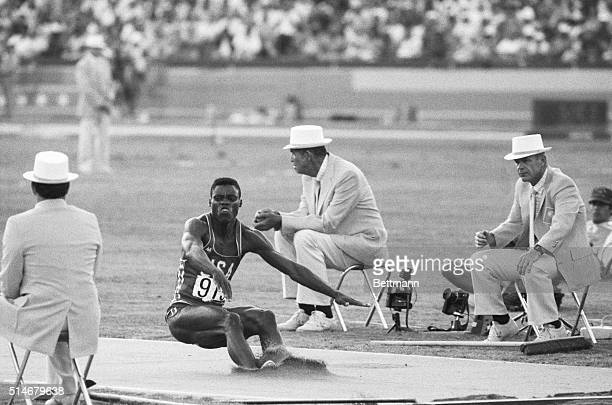 American Carl Lewis lands in the long jump event of the 1984 Summer Olympics in Los Angeles. Lewis won the gold medal for the event.