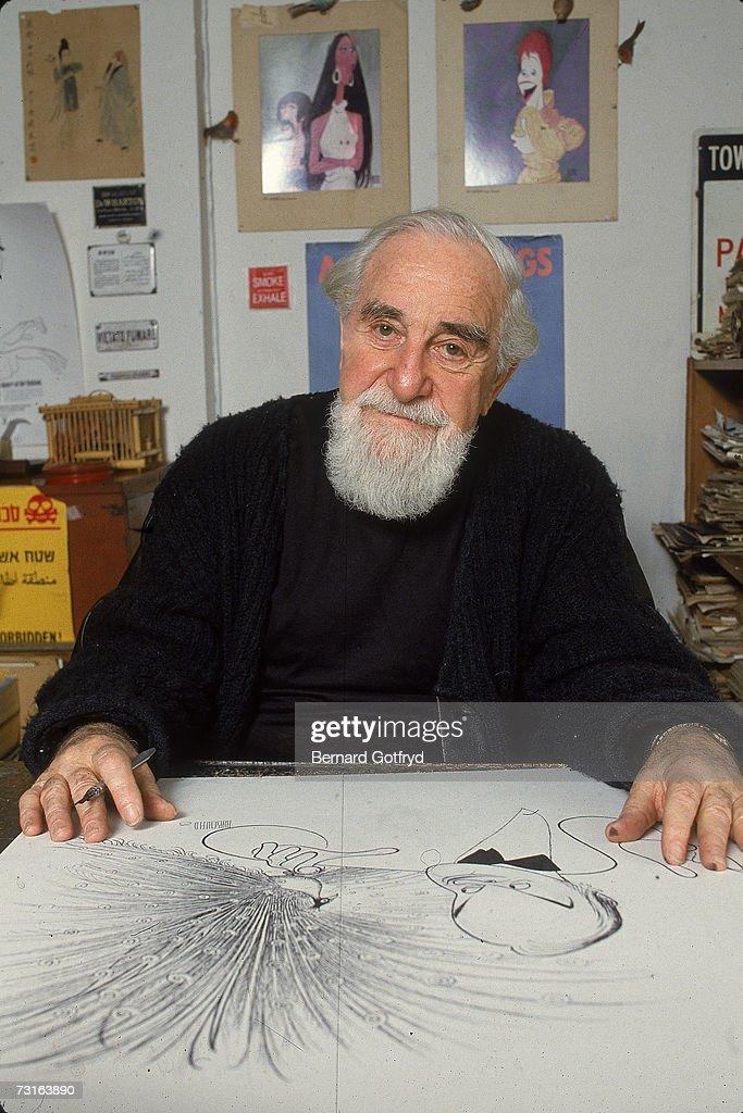 Cartoonist At Work : News Photo
