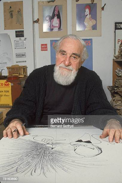 American cartoonist and caricaturist Al Hirschfeld sits behind his desk in his office surrounded by examples of his drawings New York April 20 1988