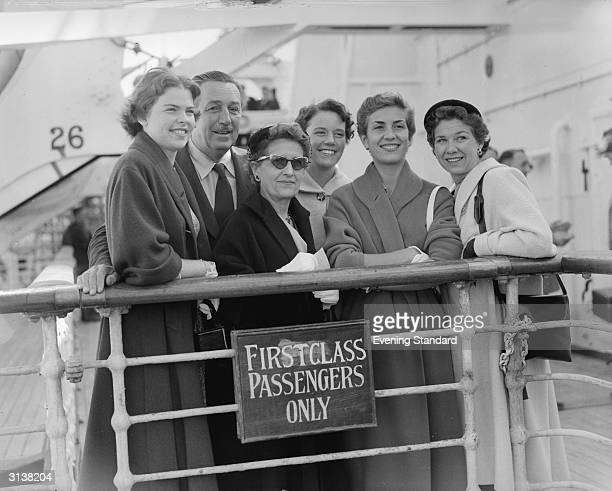 American cartoonist and filmmaker Walt Disney with his wife and two daughters Sharon and Diane and Karin Bergstrom on board a ship